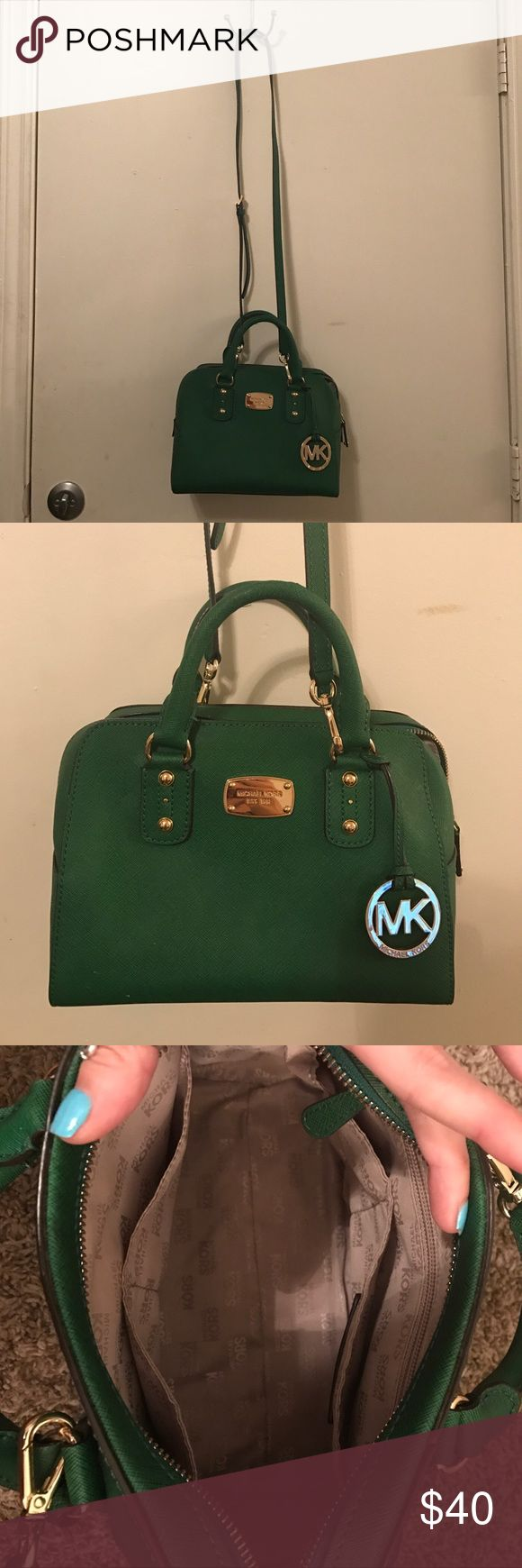 Michael Kors handbad Dark green color with gold hardware. Comes with a long cross body strap. I don't use it anymore so I thought I would sell it. It's a nice size bag. It fits a lot of stuff. It has 4 pockets plus a zipper pocket on the inside of the bag. Michael Kors Bags Crossbody Bags