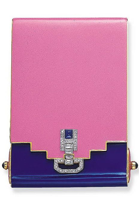 AN ELEGANT ART DECO ENAMEL, SAPPHIRE AND DIAMOND POWDER COMPACT, BY VAN CLEEF & ARPELS The pink and violet enamel rectangular case of geometric design, with cabochon sapphire terminals, to the rose and baguette-cut diamond thumb-piece, enhanced by a cabochon sapphire, opening to reveal a fitted mirror and powder compartment, 1927, 7.0 x 4.7 x 0.9 cm., with French assay mark, in its original Van Cleef & Arpels blue leather fitted case Signed Van Cleef & Arpels, Paris, no. 30051