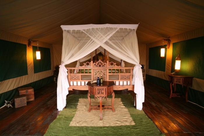 Typical guest #tent with complete wooden #carving furnishings | Holidays in Tanzania | Mbali Mbali Lodges and Camps