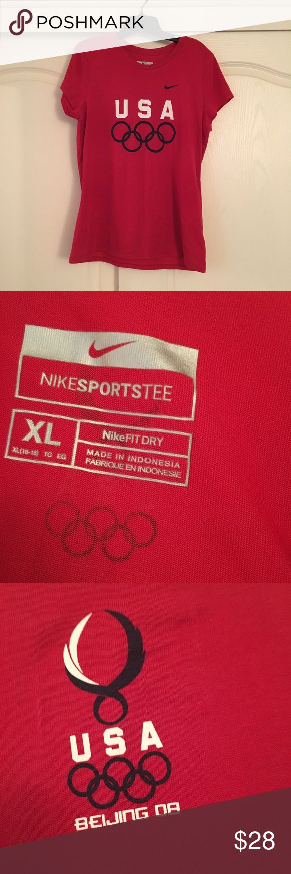 Nike Olympic 2008 Beijing tee Worn only once. Nike Olympic dryfit tee from the 2008 Beijing summer games. Perfect condition! Perfect for the sports vintage lover. Women's XL fitted Nike Tops Tees - Short Sleeve