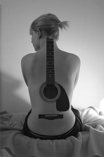 Acoustic guitar tattoo. — Definite photoshop, but cool idea...