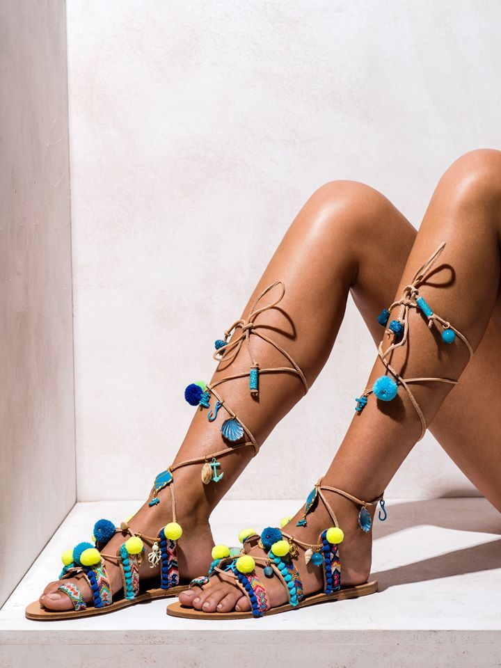 Mermaid Motel  Multi-colored macramé friendships, pom poms in blue and yellow shades, hand-painted ceramic beads, ocean themed charms and semi-precious stones.  Get the experience: http://www.elinalinardaki.com/shoes/sandals/new-collection/sandal-mermaid-motel/
