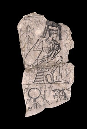 COMPASS Title: Limestone ostrakon showing a woman suckling a child