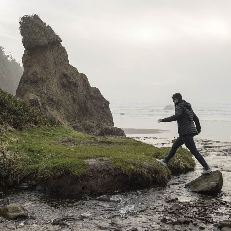 She'll take any path to the sea. Especially if it means pushing her way through a ton of overgrown plants and sliding down muddy hills.  #OregonCoast #ocean #Pacific #pnw #pnwonderland #jump #woman #nature #beautiful #beautifulplaces #tbt #throwback #throwbackthursday #rock #river #stream #Oregon