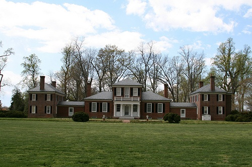 "Brandon Plantation, James River, Prince George County, Virginia, 1760s. The plantation is an active farm and was tended perhaps from 1607 on, and more clearly from 1614 on, so it is one of the longest-running agricultural enterprises in the United States. It has an unusual brick mansion in style of Palladio's ""Roman Country House"" completed in the 1760s, and was perhaps designed by Thomas Jefferson."