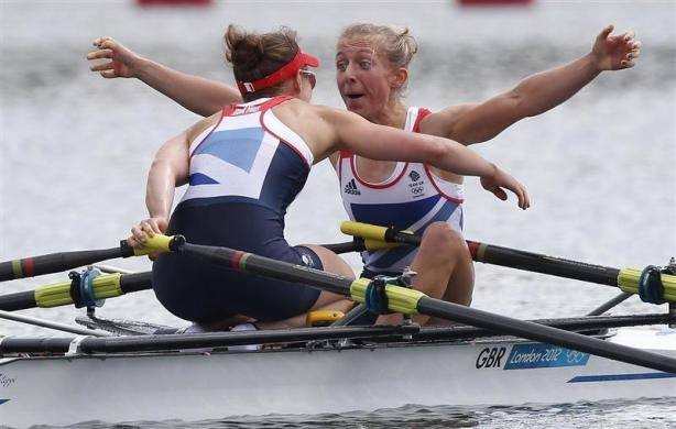 Britain's Katherine Copeland and Sophie Hosking celebrate winning the women's lightweight double sculls final of the rowing event during the London 2012 Olympic Games at Eton Dorney August 4, 2012.  REUTERS/Jim Young - http://www.PaulFDavis.com/success-speaker (info@PaulFDavis.com)
