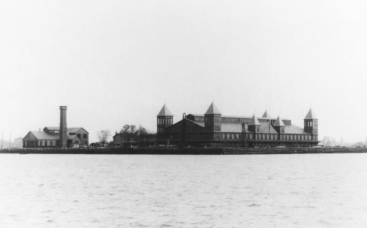 Just 5 years after it opened, the Georgia pine structures on Ellis Island burned completely to the ground. Fortunately, no one died in the June 1897 fire. But to geneaology buffs, the loss is immeasurable. Most of the immigration records dating from 1855 were destroyed. While a new, fireproof immigration station was being built  on Ellis Island, immigrant processing was transferred back to the Barge Office on the Battery in Lower Manhattan.