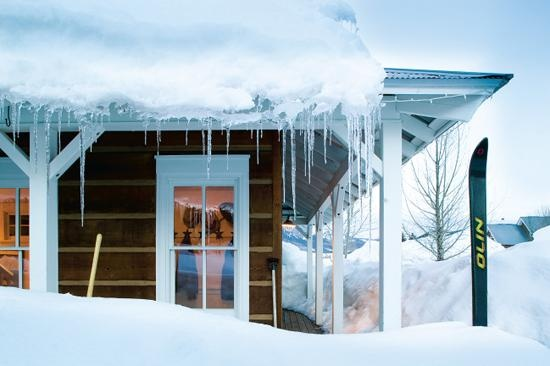 icicles, snow drifts, and skis outside the front door. photo: Tim Murphy.