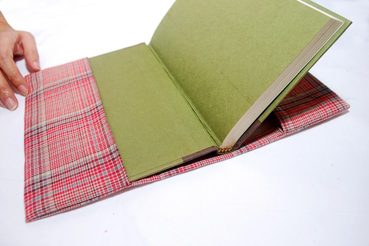 Sew a Fabric Book Cover, add handles to both sides,and elastic on both inside side(for smaller books or notepad?