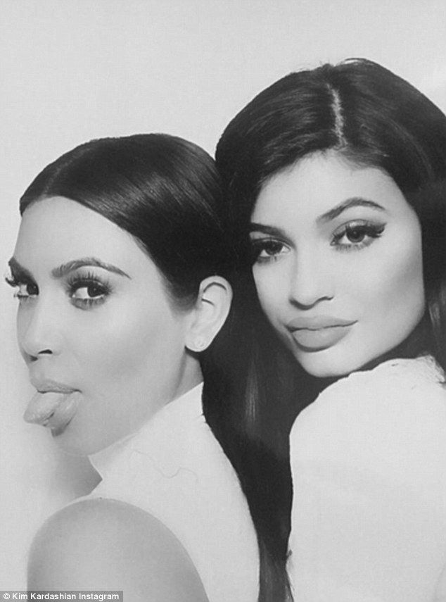 Pucker up: Kylie Jenner appeared to have a significantly plumper pout than older sister Kim Kardashian as they posed together in the photobooth at James Harden's yacht party in Marina Del Rey on Tuesday night