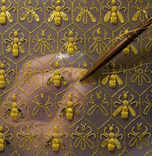 "Constellation of 69 bees, the symbol of the Empire and the emblem of the Guerlain family of ""Eaux"". Sylvie Deschamps, Maître d'art, handcrafts ""The Festive Attire"", ""L'Habit de Fête"", a covering designed as an imperial coronation robe:"
