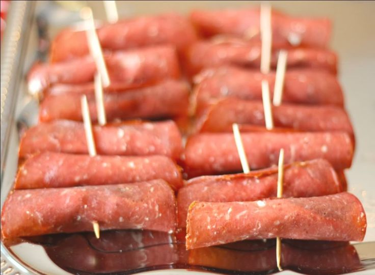 Seriously yum and super easy finger food: Pickles wrapped in cream cheese and salami