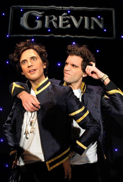 Mika with his wax statue at the Grévin museum in Paris Dec 2010