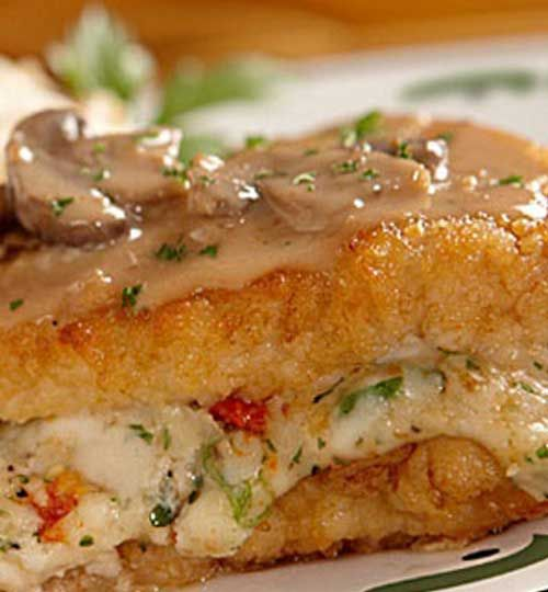 Recipe for Copycat Olive Garden Stuffed Chicken Marsala - The rich and creamy marsala and mushroom sauce was amazing and complimented the stuffed chicken breast perfectly. It's one of my favorites at the Olive Garden. With this recipe, I can make it anytime I want!