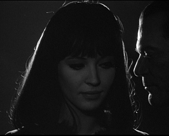 Alphaville, une étrange aventure de Lemmy (1965) Director: Jean-Luc Godard...Natacha and Lemmy in the dark..(Anna Karina, Eddie Constantine)