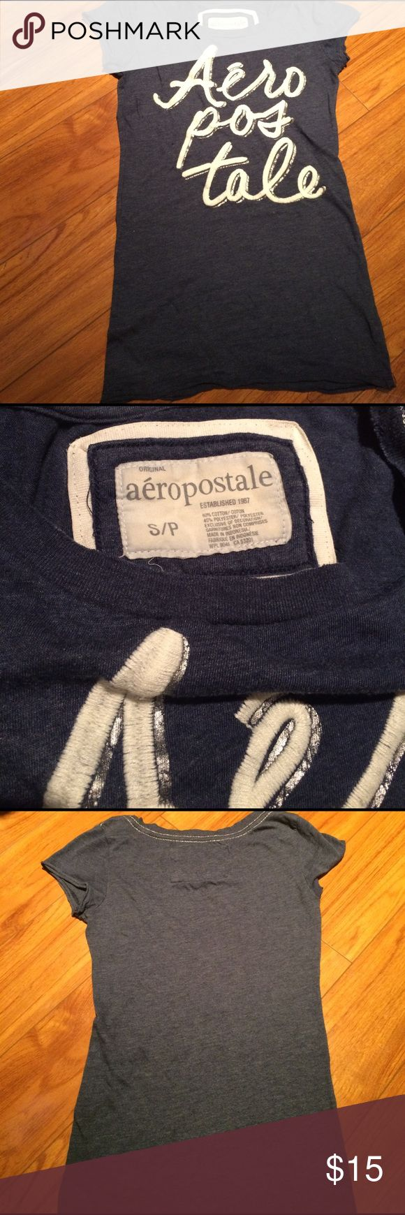 A blue with white lettering Aeropostale T-shirt A blue and white t-shirt that is short sleeve. A bit of the string is coming lose in the letters but I am open to offers Aeropostale Tops Tees - Short Sleeve