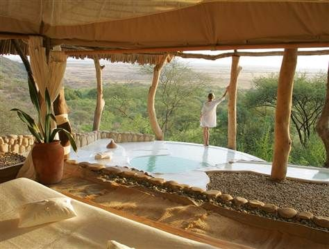 A private conservancy in Shompole, Kenya, offers sweeping views of the Great Rift Valley's volcanic hills. The Shompole Lodge stands near Lake Natron, which is one of the few remaining flamingo-breeding habitats in Africa. (bing)