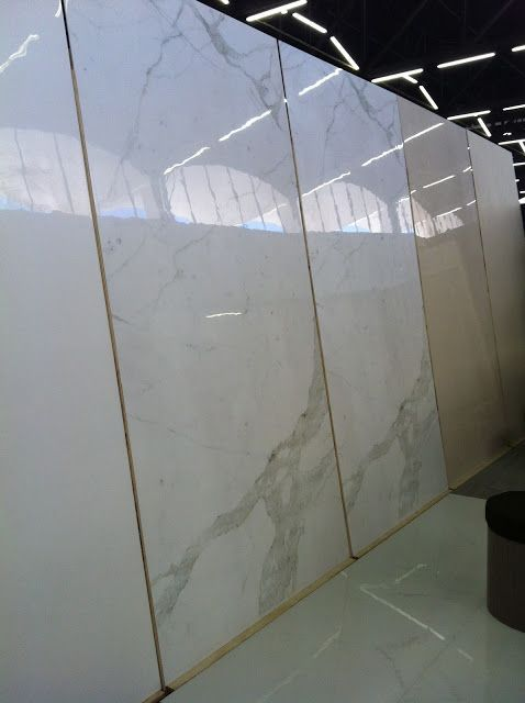 This is not Carrera Marble!!! These are actually 5'x10' PORCELAIN 2cm slabs.  Why porcelain versus the real stuff?  Porcelain is baked at a higher temp so its nearly indestructible when installed properly.  Meaning red wine spills, heat, sealers, are not an issue.  This would be FAB in a shower install = NO grout lines :)