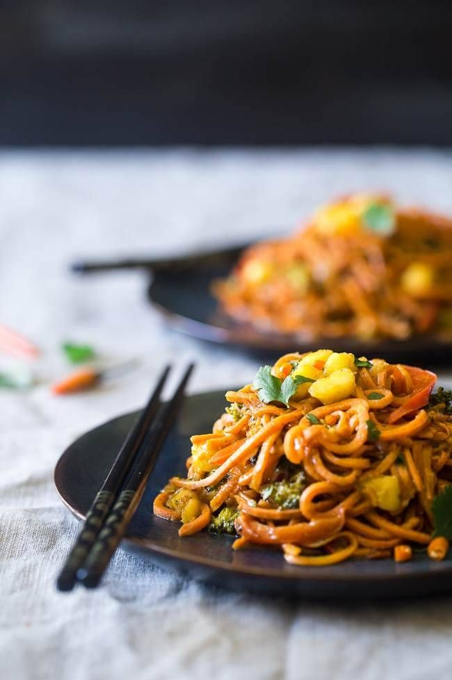 Vegan Coconut Curry with Spiralized Sweet Potato Noodles – This curry is ULTRA creamy and loaded with veggies, for a quick and easy, healthy dinner that is gluten free and vegan friendly!   Foodfaithfitness.com   @FoodFaithFit