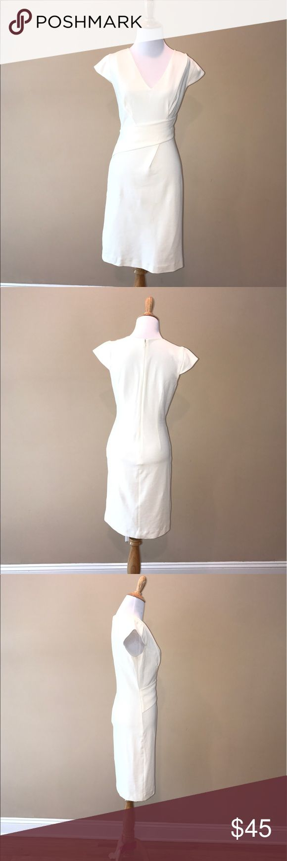 Rebecca Taylor cream cap sleeve dress size 6 Work appropriate cream Rebecca Taylor dress size 6. Faux wrap front with v neck and cap sleeves.  Concealed back zipper. Bust 32 inches waist 28 inches hips 36 inches. Dress length 37 inches. Fabric 80% cotton 15%nylon 5%polyurethanes. One small stain on back shown in photo. No trades but offers are welcome. Rebecca Taylor Dresses