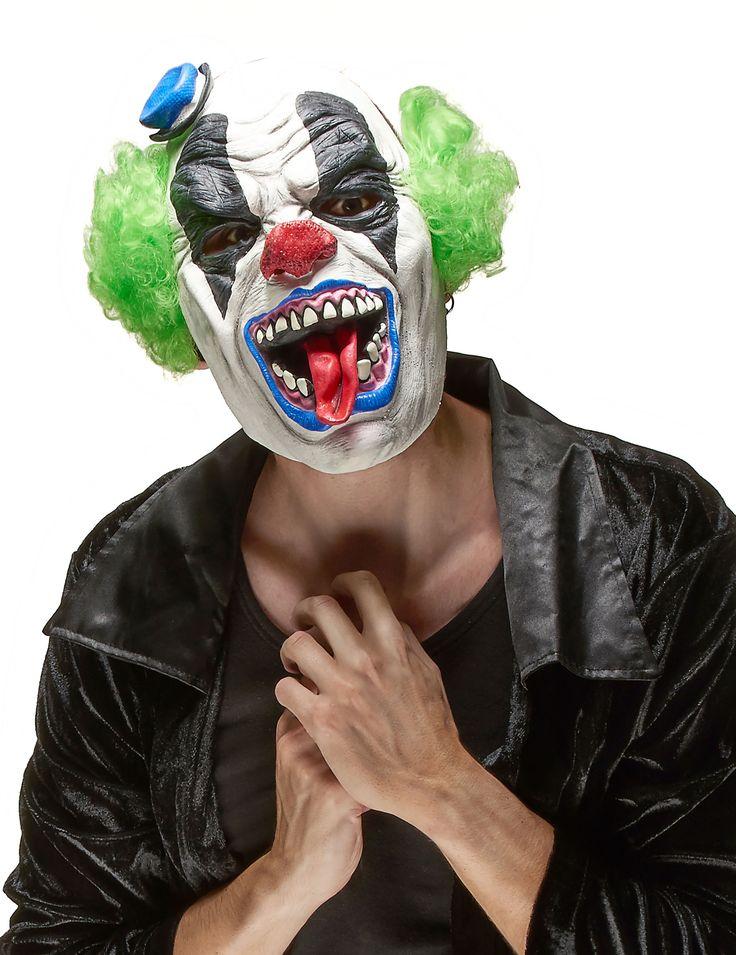 Masque latex clown terrible adulte Halloween : Ce demi-masque de clown Halloween pour adulte est en latex . Des cheveux verts sont implantés sur le côté ainsi qu'un mini-chapeau bleu. Un élastique est présent...