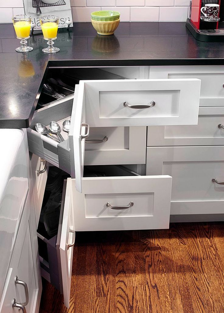 Shaker style kitchen with an L-shaped layout maximizes storage space with corner pullout drawers [Design: Nouvelle Cuisine]