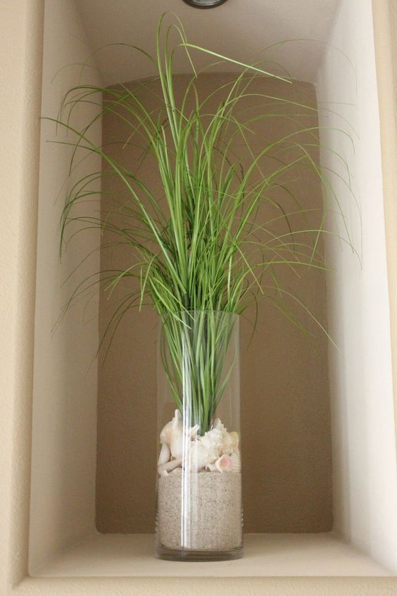 Beach grass, shells and sand coastal decor idea: