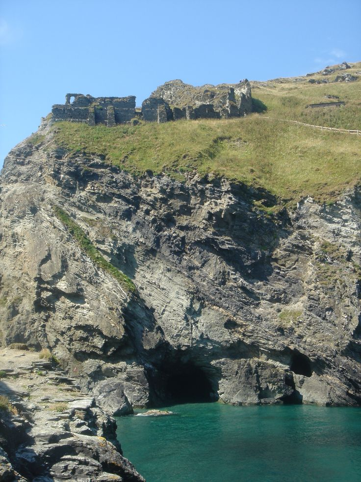 Tintagel Castle and Merlin's Cave, north Cornwall coast, England.