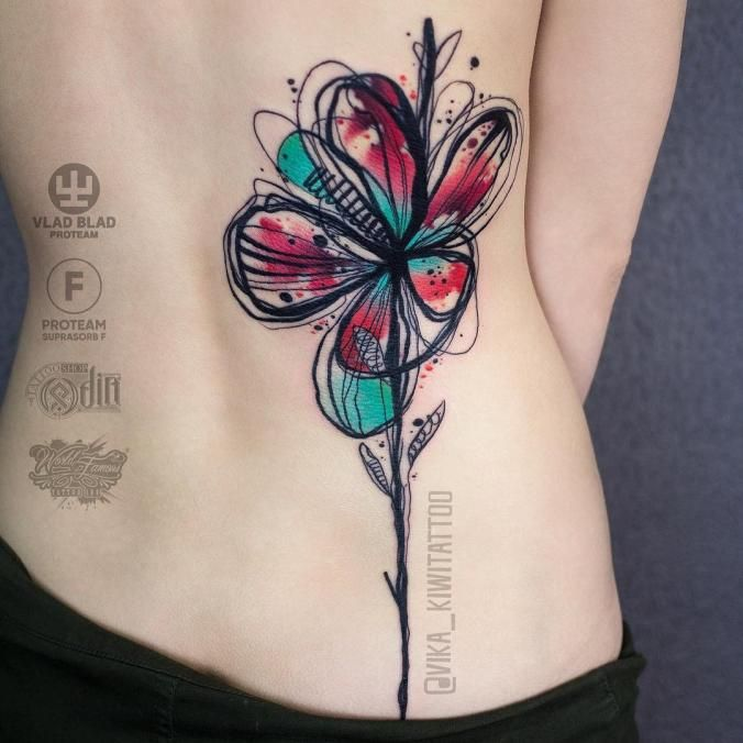Watercolor flower back tattoo