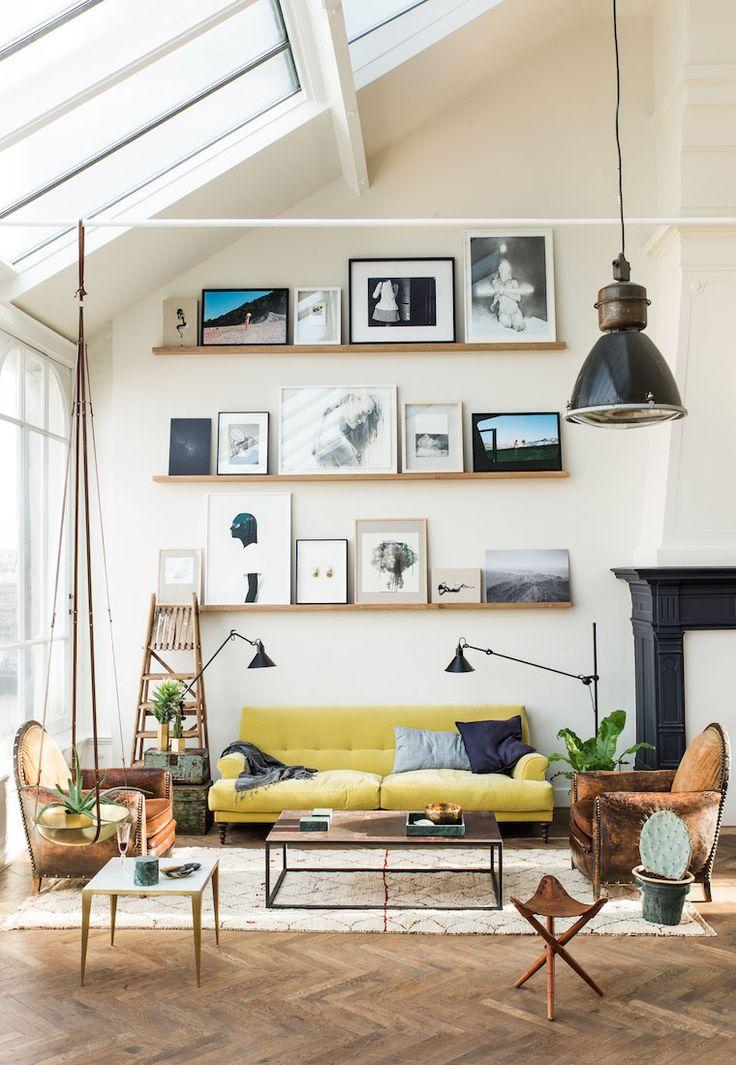 yellow velvet sofa, picture rails, leather armchair, reading lights