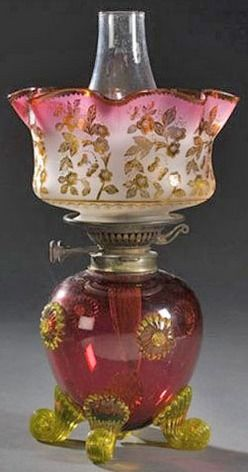 Gold Ruby Victorian Oil Lamp Having A Rubina Shade, Vaseline Applied Scrolled Feet And Decorative Prunts On The Gold Ruby Ovoid Font, The Ruffled Rubina Shade With Etched Floral Decoration - England   c.1875-1885  -  Prices4Antiques