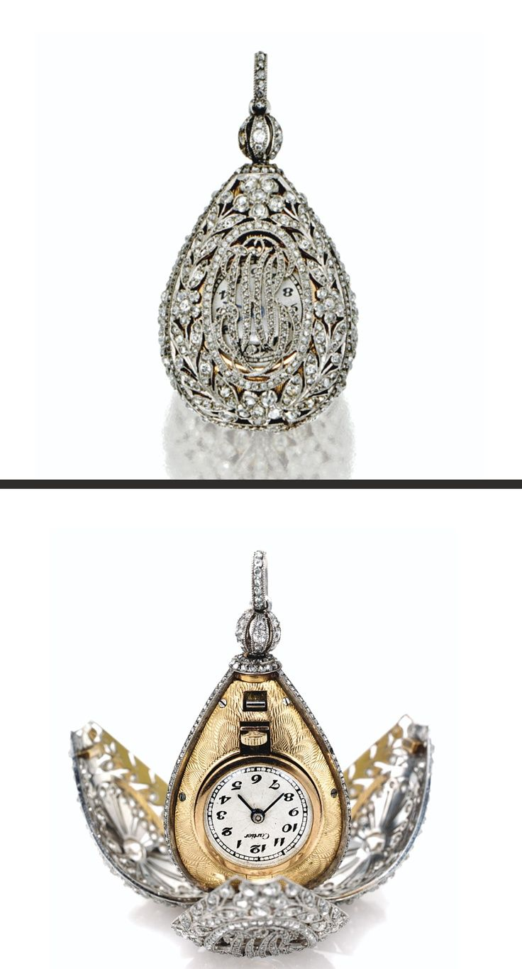 PLATINUM, GOLD AND DIAMOND PENDANT-WATCH, CARTIER, CIRCA 1910. The three-sided egg-form case of openwork laurel-wreath design decorated on two sides with oval medallions, the third with monogram CHB, set throughout with old European-cut & rose-cut diamonds in platinum, separated by rose-cut diamond ribs, the interior case of guilloché-patterned gold, two sides with circular glazed compartments for photos, the third featuring a circular matte cream dial with Arabic numerals & blued steel…