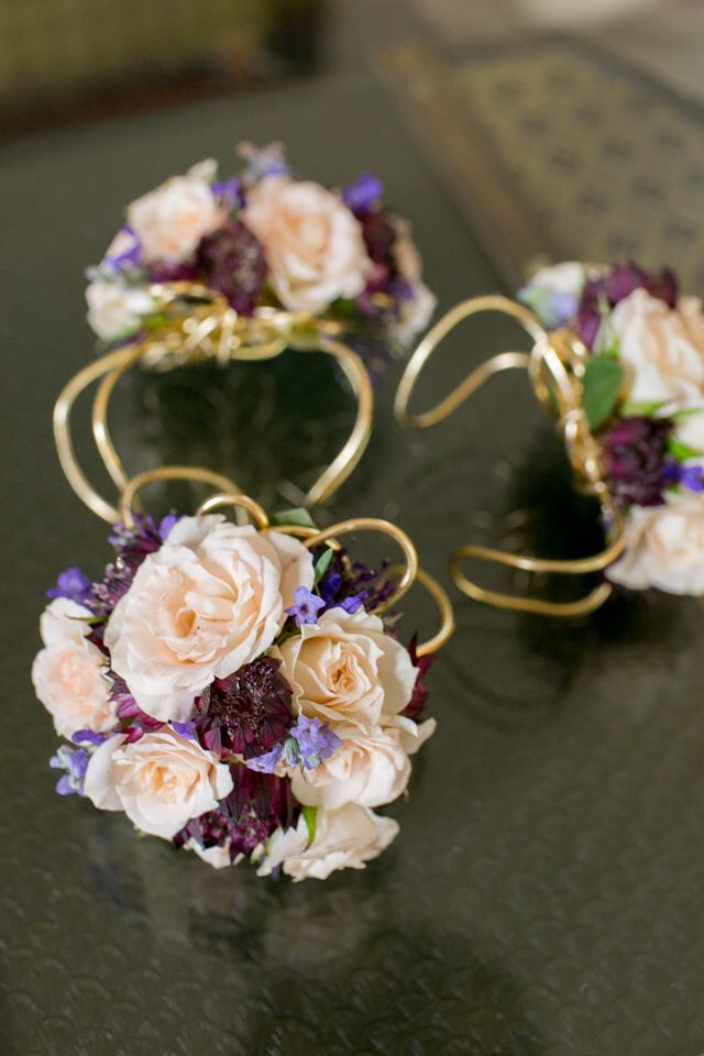 Good wire wristlet corsages adorned with blush, eggplant and lavender flowers for the mums.