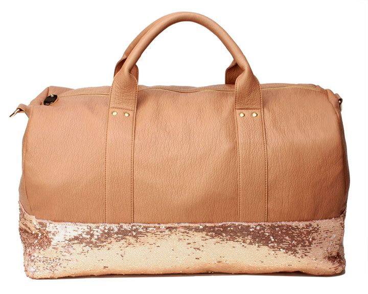 Having the perfect duffle bag for a weekend getaway makes everything easier. And one dipped in sequins? Even better! #luggage