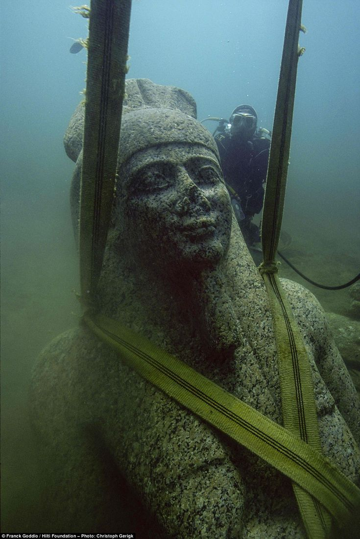 Lost treasures of sunken cities to go on show after more than 1,000 years submerged in the waters of the Nile delta.  Strapped in: A diver secures a 5.4m statue of Hapy, a divine personification of the Nile floods, to be lifted out of the waters. The colossal red granite carving will one of the exhibition's centrepieces. The six-tonne statue, which dates to the 4th Century BC is the largest known example of a Hapy statue.