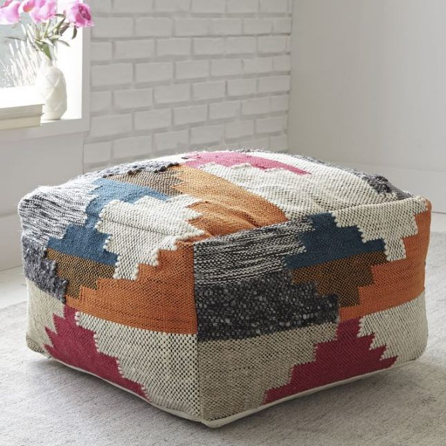 Loving this textured wool pouf that will go perfectly in your backyard.