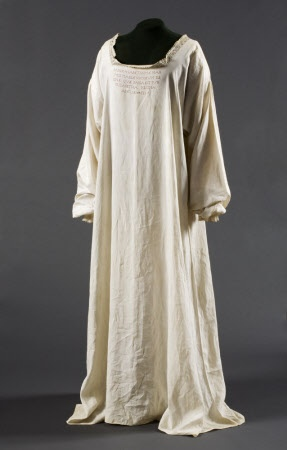 Chemise belonging to Mary, Queen of Scots in which she was executed at Fotheringhay Castle. Of fine linen with drawn thread borders incribed on the bodice in red and dated Feb 11 1587. This is an Elizabethan undergarment and only one other of this type is known to survive.