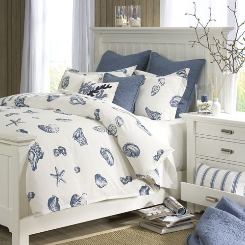 Beach house bedroom set with blue and white shell comforter. #beachhouse
