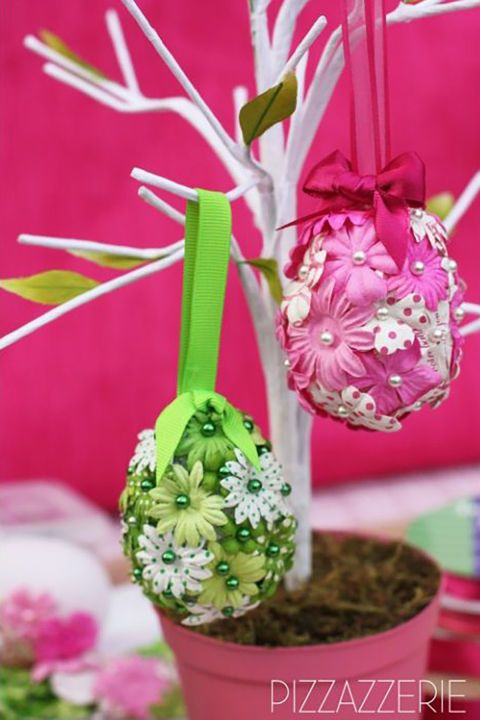 DIY Flower Eggs:  Using pushpins, Styrofoam eggs, and mini flowers, you'll quickly have a dozen of these adorable ornaments for Easter and throughout the spring.