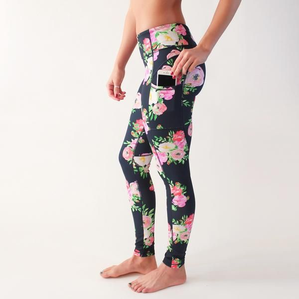 These full length pants with pockets will provide comfort and style in the gym, studio, and beyond. (Rosa print over dark navy base.) Fit and Product Details Tight leg, sits 2 fingers below belly button Pockets on the sides that fit most large phones Back zipper pocket for smaller valuables Breathable crotch gusset Tagless Extra Small: 0-2Small: 4-6Medium: 8-10Large: 12-14Extra Large: 16-18 Fabric and Care Nylon/Spandex blend Lightweight, breathable, squat proof (never sheer) Machine w...