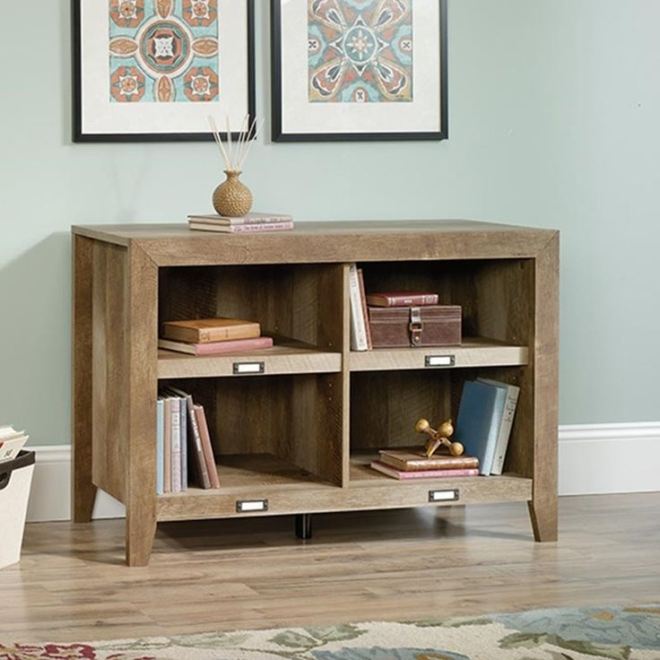 Whether Mom needs a place to store files in her home office or a spot to keep her favorite book club reads, this cute bookshelf will do the trick. This Sauder bookcase features 2 adjustable shelves in an oak brown finish and labels for each shelf. It can also hold a TV—perfect Mother's Day gift! Dakota Pass Short Bookcase | Weekends Only Furniture and Mattress