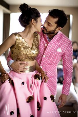 Couture - Bride in an Embellished Gold Shell Blouse with a Poofy Pink Skirt | WedMeGood | Groom in a Pink and White Sherwani #wedmegood #indianbride #indianwedding #bridal #sherwani #couture #uniqueoutfit #pink #gold