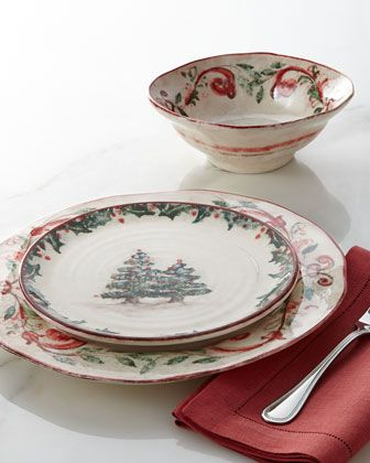 Christmas Dinnerware...Horchow @ Neiman Marcus. The bowl and the plate underneath are the pattern that I like the most.