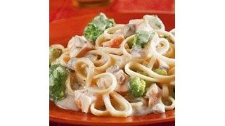 Linguini is mixed with pieces of tender chicken and broccoli flowerets and coated with a rich, satiny Alfredo sauce featuring Campbell's(R) Condensed Cream ofMushroom Soup to make aquick and fabulousdish.