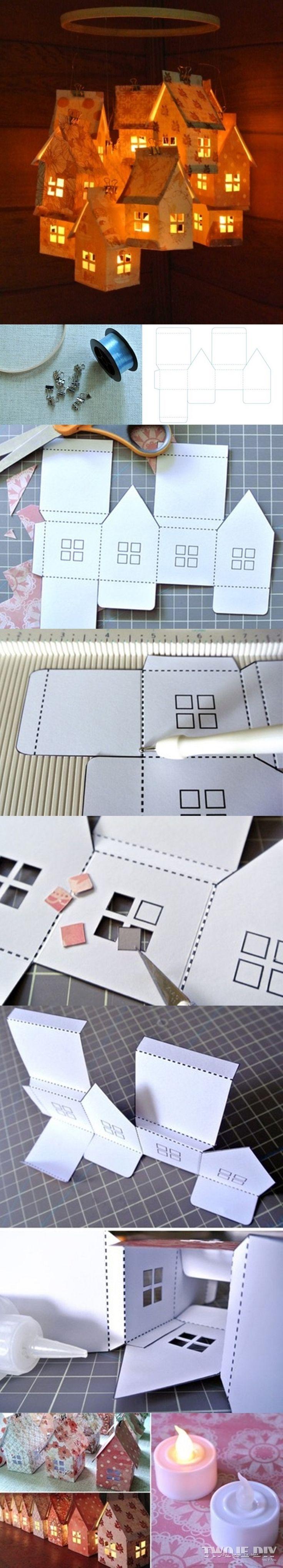 Tiny lit houses. (Mobile?) Link is broken. Looks like scrapbook paper, battery tea lights.   Domki latarnie