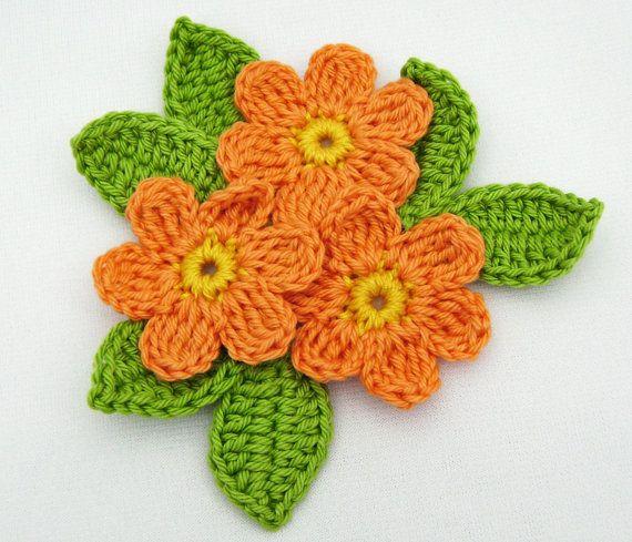 Brooch of Orange Crocheted Flowers with Green by DaffodilCorner, $13.00