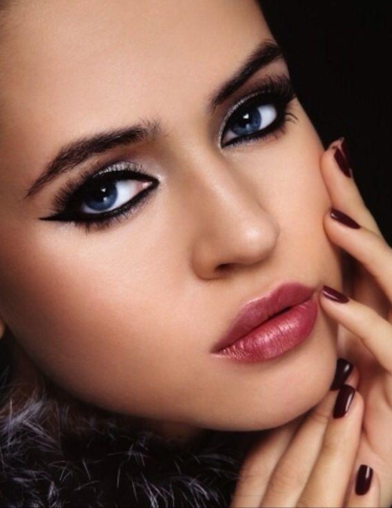 Beautiful make up look, burgundy lips , silver eye shadow , cat winged eye liner
