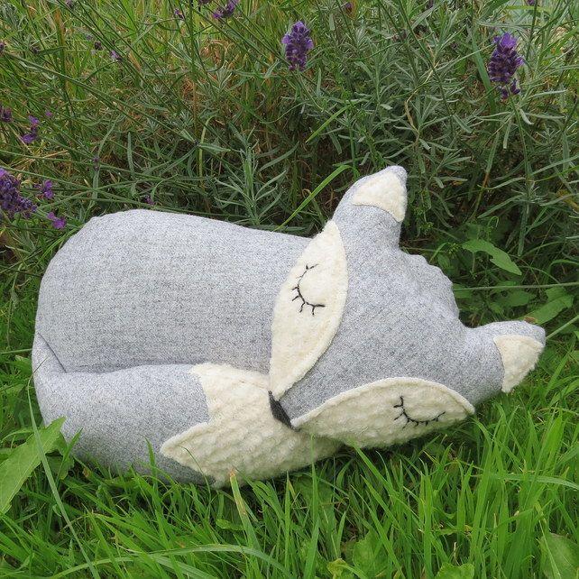 A snoozy fox cushion.  32cm in length.