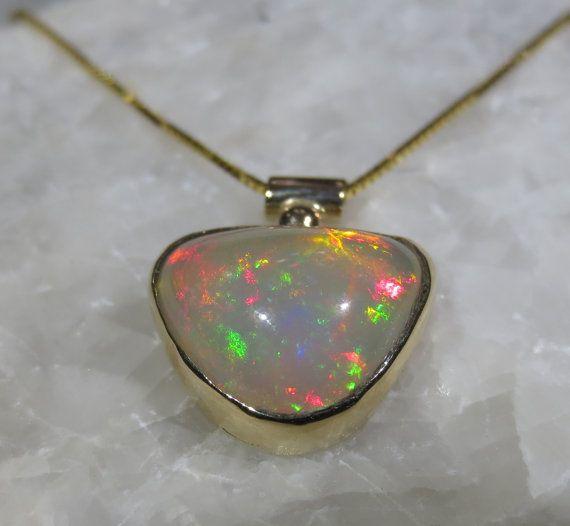 124 best ethiopian opal jewelry images on pinterest opal jewelry natural ethiopian opal pendant 14k yellow gold by zozodesignsusa 70000 aloadofball Choice Image