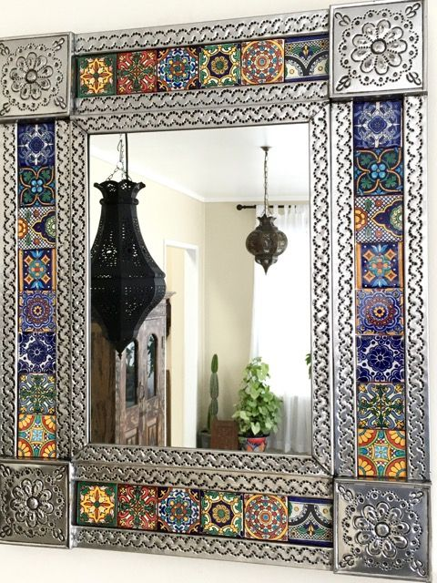 620mm high x 515mm wide.  A gorgeous hand punched tin mirror with hand made ceramic talavera tiles from Mexico. Very ornate and can be hung either landscape or portrait.  Not available to be couriered sorry, due to fragile mirror glass.